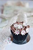 A cupcake decorated with flowers