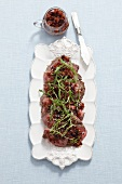 Beef carpaccio with dried tomatoes and a cranberry dressing