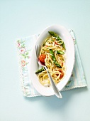 Pasta with green asparagus and cherry tomatoes