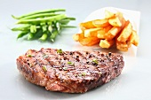 Beef steak with chips and green beans