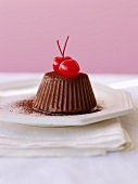 A chocolate truffle cake with cocktail cherries