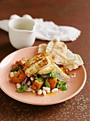 Haloumi on a warm squash and bean salad