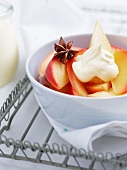 Poached apple slices with creme fraiche