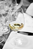A glass of white wine at a tasting session