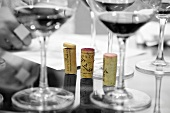 Corks and glasses of wine at a tasting session