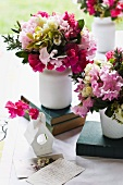 Colourful bunches of flowers as table decoration