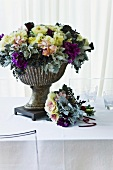 A vase of flowers in an ornamental pot