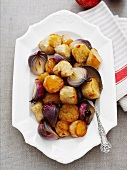 Potatoes and red onions with maple syrup