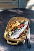 Stuffed bass with rosemary potatoes and cocktail tomatoes