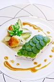 Pollack with slices of herb jelly and asparagus