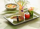 Assorted Sushi on a Green Plate; Chopsticks