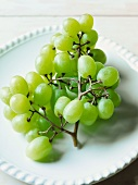 Bunch of Green Grapes on a White Plate
