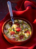 Clafouti with cherry tomatoes and cheese