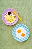 Fried eggs with chips (artistic)