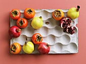 Various exotic fruits in a paper carton