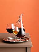 Red wine in a glass and a carafe and a glass of white wine