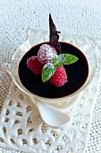 Bavarian cream with chocolate sauce and raspberries