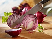 Red onions being sliced
