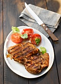 Beef steak with grilled tomatoes