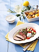 Lamb with lemon potatoes and tzatziki