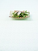 Green bean salad with artichokes and pine nuts