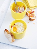 Oeufs cocotte with chorizo and white bread