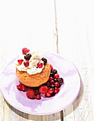 Baba au rhum with berries