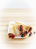 Puff pastry wraps filled with berries and brittle