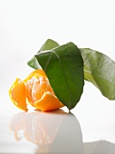 A clementine with leaves