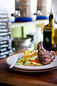 Lamb cutlet with sumach and apple-celery salad