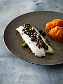 Fish filet with olives, anchovies and pumpkin puree