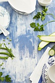 Zucchini, parsley, peas and tableware