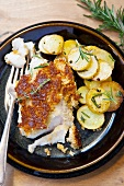 Fish fillet with parmesan crust and roast potatoes