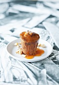 An almond and date cake with an orange and caramel sauce