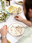 Emptied plates in front of a man