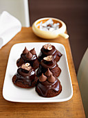 Chocolate and hazelnut tartlets with chocolate glaze