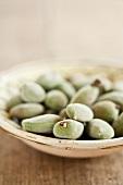 Fresh almonds in a ceramic bowl