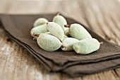 Fresh almonds on a linen napkin