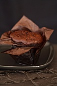 Chocolate cake wrapped in baking paper