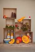 An autumnal arrangement displayed in cardboard boxes featuring pumpkin soup