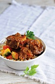 Lamb ragout with courgettes and coriander on a bed of couscous