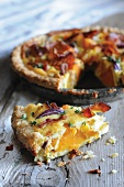 Pumpkin pie with bacon and red onions