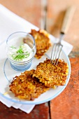 Sauerkraut fitters with unripe spelt grains and a garlic dip