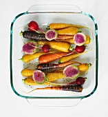 Root Vegetables Ready for Roasting with Cracked Pepper and Olive Oil (Rainbow Carrots, Baby Radish, Beets, and Turnips)