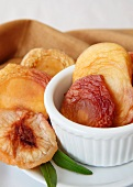 Organic Dried White Peaches in a Small Bowl and Plate
