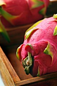Whole Dragon Fruit in a Wooden Box; Close Up
