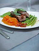 Beef roulade with tomato confit and sage
