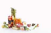 Pickled vegetables and fruit, pickling jars and ice cubes