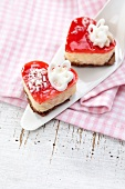 Two heart-shaped cream cakes on the cake slice