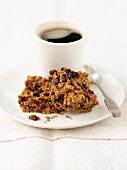 Raisins flapjacks and a cup of coffee